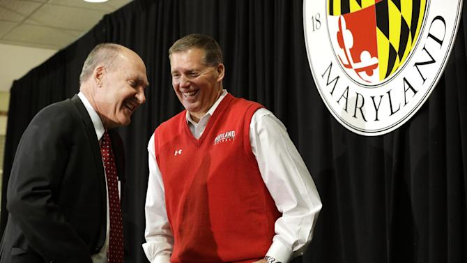 Big Ten Commissioner James Delany, left, speaks with Maryland football coach Randy Edsall after a news conference that was held to announce Maryland's decision to move to the Big Ten in College Park, Md., Monday, Nov. 19, 2012. Maryland is joining the Big Ten, leaving the Atlantic Coast Conference in a shocker of a move in the world of conference realignment that was driven by the school's budget woes. (AP Photo/Patrick Semansky)