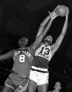 FILE - In this March 18, 1966, file photo, Philadelphia 76ers' Wilt Chamberlain, right, grabs a rebound over New York Knicks' Walt Bellamy. Bellamy, the Hall of Fame center who averaged 20.1 points and 13.7 rebounds in 14 seasons in the NBA, died Saturday, Nov. 2, 2013. He was 74. The Atlanta Hawks confirmed the death, but didn't provide details. (AP Photo)