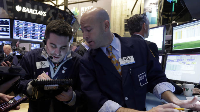 Trader Joseph Lawler, left, and specialist Jay Woods work on the floor of the New York Stock Exchange Friday, Dec. 21, 2012. Stocks opened sharply lower Friday on Wall Street after House Republicans called off a vote on tax rates and left federal budget talks in disarray 10 days before sweeping tax increases and government spending cuts take effect. (AP Photo/Richard Drew)