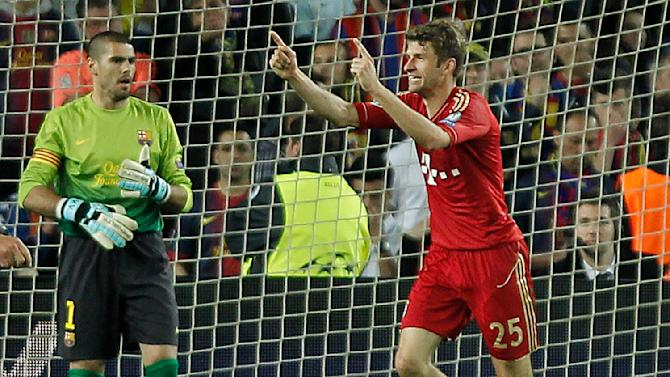 Bayern's Thomas Mueller celebrates after scoring while Barcelona goalkeeper Victor Valdes , left, looks on during the Champions League semifinal second leg soccer match between FC Barcelona and Bayern Munich at the Camp Nou stadium in Barcelona, Wednesday, May 1, 2013. (AP Photo/Andres Kudacki)