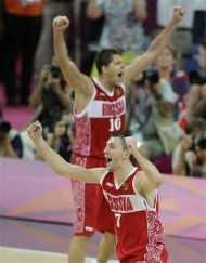 Russia&#39;s Vitaliy Fridzon (7) and Victor Khryapa celebrate after defeating Argentina, 81-77, in the men&#39;s bronze medal basketball game at the 2012 Summer Olympics, Sunday, Aug. 12, 2012, in London. (AP Photo/Morry Gash)