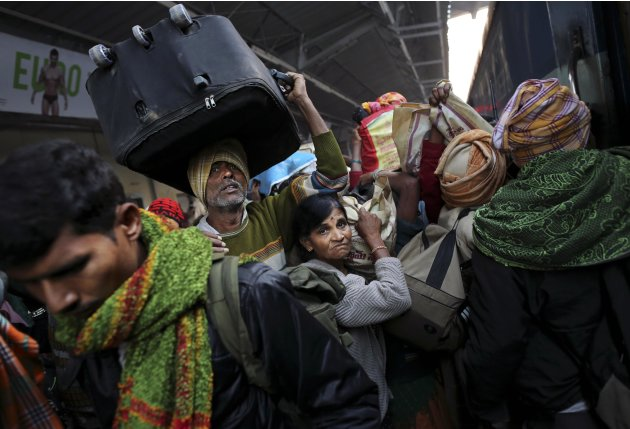 Indians crowd on a train on platform six near where a stampede took pace a night before, at a station in Allahabad, India, Monday, Feb. 11, 2013. The death toll from a stampede in a train station rose