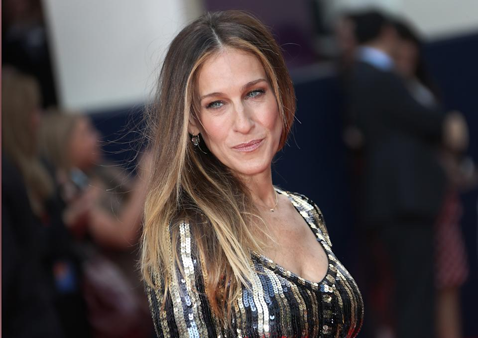 Sarah Jessica Parker arrives for the opening night of Charlie and the Chocolate Factory, a new stage musical based on Roald Dahl's popular story about Willy Wonka and his amazing Chocolate Factory, at the Drury Lane Theatre in central London, Tuesday, June 25, 2013. (Photo by Joel Ryan/Invision/AP)