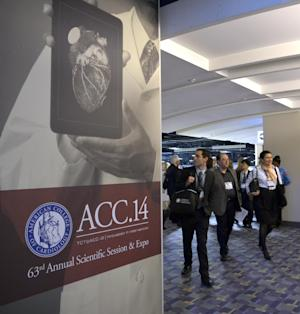In this Saturday, March 29, 2014 photo, people attend the American College of Cardiology's Annual Scientific Session and Expo in Washington. A large study in Sweden found that a blood test plus the usual electrocardiogram of the heartbeat were 99 percent accurate at showing which patients could safely be sent home rather than be admitted for observation and more diagnostics. (AP Photo/Susan Walsh)