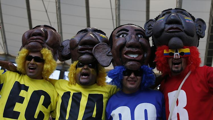 Ecuador's fans pose before the start of the 2014 World Cup Group E soccer match against France at the Baixada arena in Curitiba