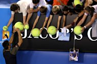 MELBOURNE, AUSTRALIA - JANUARY 24:  Novak Djokovic of Serbia signs autographs for fans after winning his Semifinal match against David Ferrer of Spain during day eleven of the 2013 Australian Open at Melbourne Park on January 24, 2013 in Melbourne, Australia.  (Photo by Michael Dodge/Getty Images)