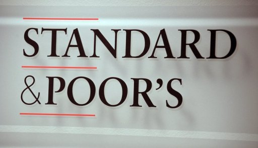 <p>Standard & Poor's cut Argentina's credit rating by one notch Tuesday, four days after a key New York court ruling on Argentine bonds increased pressure on the government's ability to manage its debts.</p>
