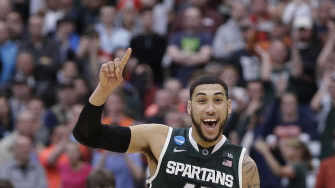 Michigan State's Denzel Valentine (45) celebrates after the East Regional final against Louisville in the NCAA men's college basketball tournament Sunday, March 29, 2015, in Syracuse, N.Y. Michigan State won 76-70. (AP Photo/Seth Wenig)