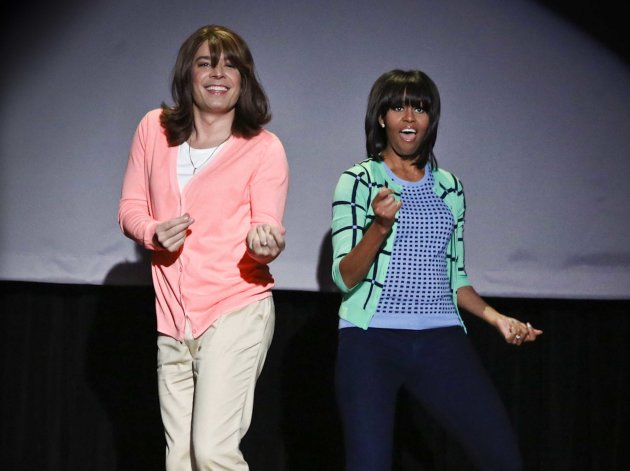 "This image released by NBC shows host Jimmy Fallon dressed as a mom, left, dancing with first lady Michelle Obama during an appearance of ""Late Night with Jimmy Fallon,"" Friday, Feb. 22, 2013 in New York. Obama returned to the show to promote her ""Let's Move"" campaign and to perform in a sketch called ""Evolution of Mom Dancing,"" airs tonight at 12:35am ET on NBC. (AP Photo/NBC, Lloyd Bishop)"