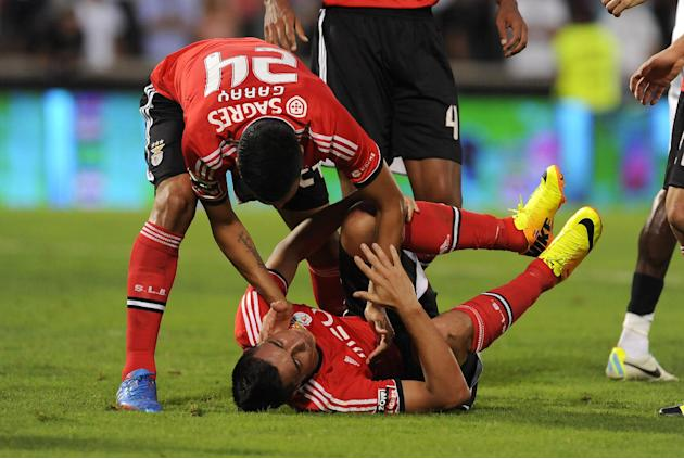 Benfica's Ezequiel Garay, left, celebrates the goal from Oscar Cardozo, below, against Vitoria Guimaraes in a Portuguese League soccer match at D. Afonso Henrique stadium in Guimaraes, Portugal, Sunda