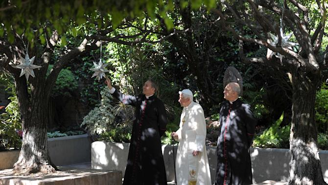 In this picture made available by the Vatican newspaper Osservatore Romano, Pope Benedict XVI, center, walks in the yard of Colegio de Miraflores in Leon, Mexico, Saturday March 24, 2012. Benedict arrived in Mexico Friday afternoon, a decade after the late Pope John Paul II's last visit, and will travel to Cuba on Monday.  (AP Photo/Osservatore Romano)