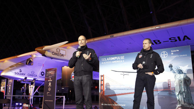 Bertrand Piccard, left, Solar Impulse Initiator, Chairman and Pilot and André Borschberg, right, Solar Impulse Co-Founder, CEO and Pilot, speak during a press conference with the Solar Impulse solar-powered plane at Moffett Airfield, NASA Ames Research Center in Mountain View, Calif., on Wednesday, March 28, 2013. A solar-powered plane that has wowed aviation fans in Europe is set to travel across the United States with stops in Phoenix, Dallas, Washington, D.C., and New York, organizers of the trip announced Thursday. The Solar Impulse is powered by about 12,000 photovoltaic cells that allow it to fly without jet fuel. It has the wing span of a commercial airplane but the weight of the average family car. (AP Photo/Tony Avelar)
