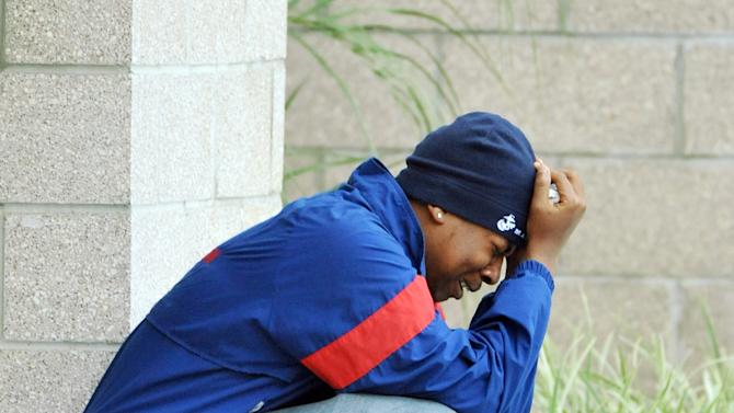 A Wolfson High School classmate of Jordan Davis breaks down outside the funeral home where the visitation with Davis' family was taking place at the Hardage-Giddens Funeral Home in Mandarin area of Jacksonville, Fla., late Wednesday afternoon, Nov. 28, 2012.  Michael David Dunn has been charged with fatally shooting Davis outside a Jacksonville convenience store following an argument that was triggered because the music coming from the teen's car was too loud. (AP Photo/The Florida Times-Union, Bob Self)