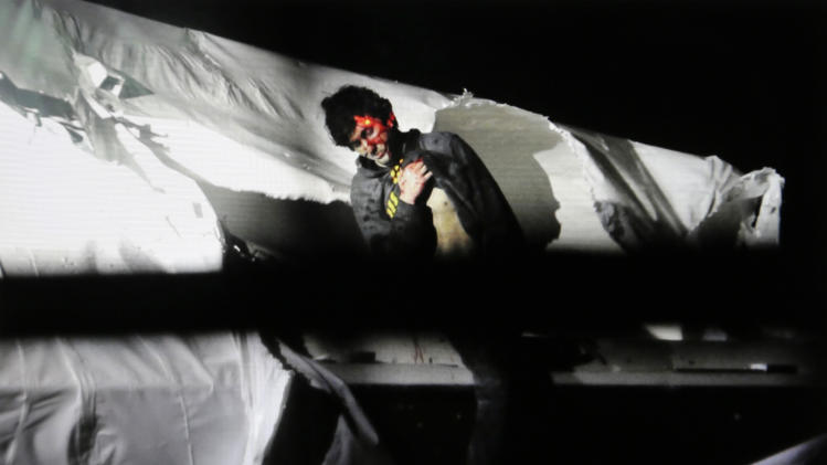 In this Friday, April 19, 2013 Massachusetts State Police photo, 19-year-old Boston Marathon bombing suspect Dzhokhar Tsarnaev leans over in a boat at the time of his capture by law enforcement authorities in Watertown, Mass. (AP Photo/Massachusetts State Police, Sean Murphy)
