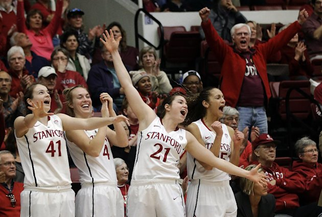 FILE - In this Jan. 27, 2013, file photo, Stanford's Bonnie Samuelson (41), Taylor Greenfield (4), Sara James (21) and Erica Payne (25) celebrate in the closing seconds of their 69-56 win over Colorad