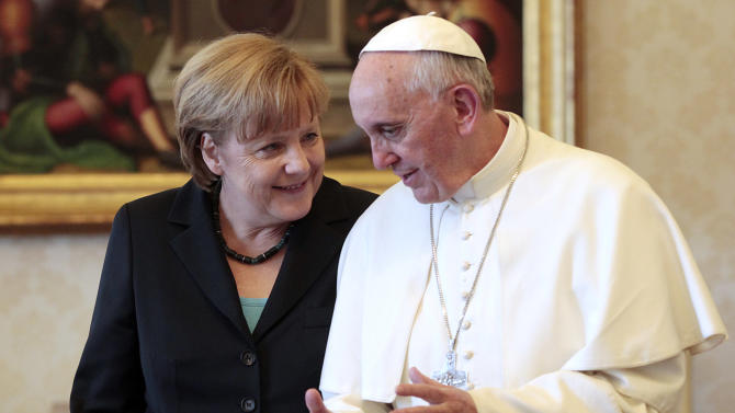 Pope Francis meets with German Chancellor Angela Merkel during a private audience at the Vatican, Saturday, May 18, 2013. (AP Photo/Gregorio Borgia, Pool)