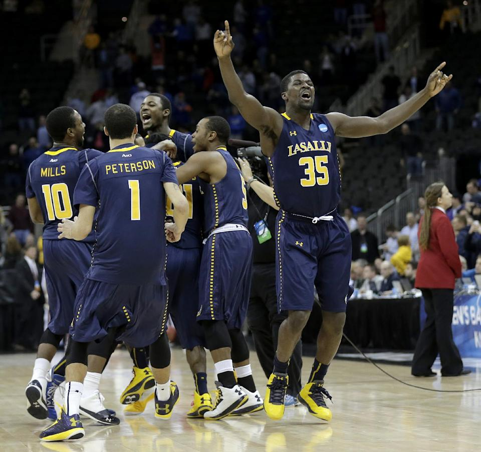 La Salle players celebrate after defeating Mississippi 76-74 in a third-round game of the NCAA college basketball tournament on Sunday, March 24, 2013, in Kansas City, Mo. (AP Photo/Charlie Riedel)