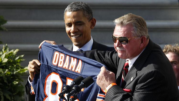 "FILE - In this Oct. 7,2011 file photo, former Chicago Bears head football coach Mike Ditka presents President Barack Obama with a jersey as the 1985 Super Bowl XX Champions Chicago Bears football team are honored on the South Lawn of  the White House in Washington. In a rare show of unity, President Barack Obama and challenger Mitt Romney took turns praising Washington Redskins rookie quarterback Robert Griffin III a couple of weeks ago for a video that aired on the Fox network NFL pregame show. They uttered polished, rote lines such as Romney's ""RG3 hasn't been in Washington very long, but he's already created change"" and Obama's ""You're welcome at my house for a pickup game anytime.""  (AP Photo/Charles Dharapak, File)"