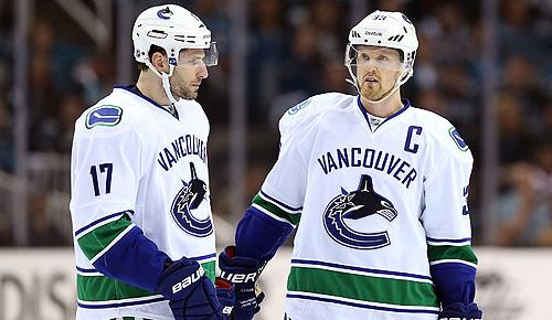Vancouver Canucks' Ryan Kesler and Henrik Sedin
