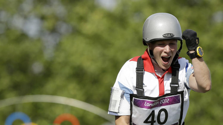 Zara Phillips, of Great Britain,  reacts after riding her horse High Kingdom in the equestrian eventing cross-country stage at the 2012 Summer Olympics, Monday, July 30, 2012, in London. (AP Photo/Charlie Riedel)