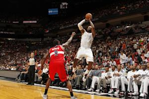 James scores 23, Heat easily beat Wizards 102-72