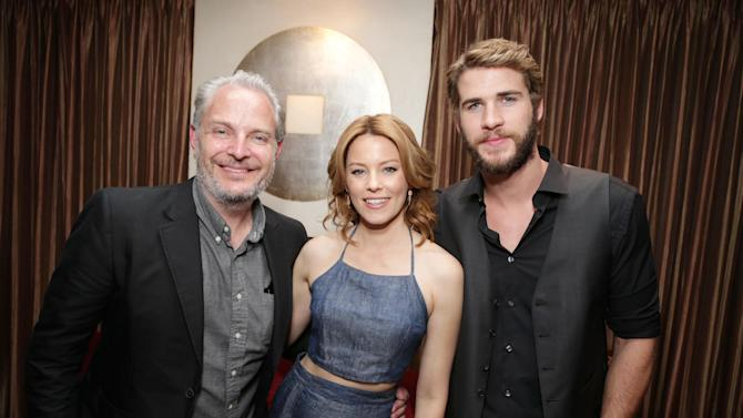 """Francis Lawrence, director of the upcoming film """"The Hunger Games: Catching Fire"""" and Elizabeth Banks and Liam Hemsworth, cast members in the upcoming film """"The Hunger Games: Catching Fire"""" at Lionsgate Presentation at 2013 CinemaCon, on Thursday, April, 18th, 2013 in Las Vegas. (Photo by Eric Charbonneau/Invision for Lionsgate/AP Images)"""