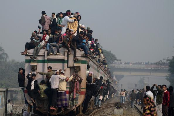 Muslim devotees arrive on an overcrowded train to attend the Biswa Ijtema or World Muslim Congregation at Tongi, about 30 kms north of Dhaka on January 13, 2013. At least three million Muslims joined