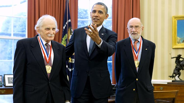 President Barack Obama meets with recipients of the 2013 Fermi Award, scientists Allen Bard, left and Andrew Sessler, in the Oval Office of the White House in Washington, Monday, Feb. 3, 2014. (AP Photo/Jacquelyn Martin)