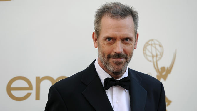 """FILE - In this Sept. 18, 2011 file photo, actor Hugh Laurie arrives at the 63rd Primetime Emmy Awards in Los Angeles. Laurie was nominated for an Emmy for best actor for his role in """"House.""""  (AP Photo/Chris Pizzello, file)"""