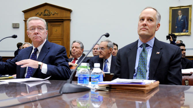 FILE - In this Dec. 9, 2008, file photo, former Freddie Mac CEO Richard Syron, left, and former Fannie Mae CEO Daniel Mudd wait to testify on Capitol Hill in Washington. The former Countrywide Financial Corp., whose subprime loans helped start the nation's foreclosure crisis, made hundreds of discount loans to buy influence with members of Congress, congressional staff, top government officials and executives of troubled mortgage giant Fannie Mae, according to a House report. (AP Photo/Susan Walsh, File)