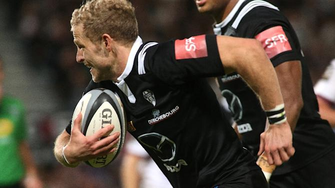 Brive's Guillaume Namy runs with the ball during their French Top 14 rugby union match against Bordeaux, at the Amede Domenech stadium in Brive, on November 7, 2015