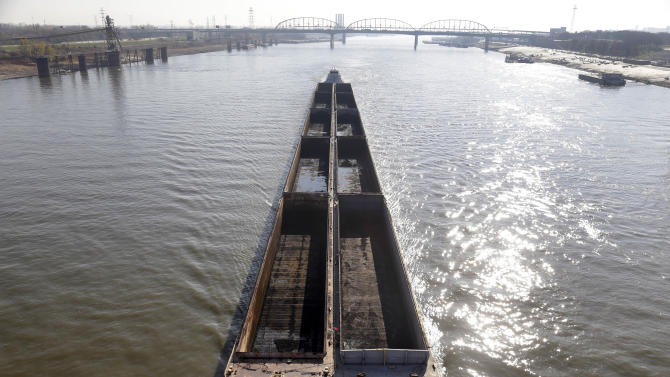 A barge powers its way up the Mississippi River Friday, Nov. 16, 2012, in St. Louis. A top Corps of Engineers official has ordered the release of water from an upper Mississippi River reservoir in an effort to avoid closure of the river at St. Louis to barge traffic due to low water levels caused by drought. (AP Photo/Jeff Roberson)