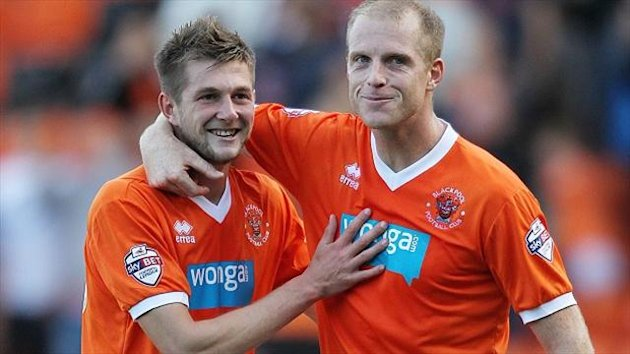 A 75th-minute strike from substitute Tom Barkhuizen, left, earned Blackpool a 1-0 home win over relegated Reading