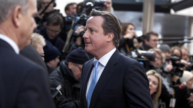 British Prime Minister David Cameron, center, arrives for an EU summit Brussels on Thursday, March 14, 2013. European Union heads of state and government meet for a two-day summit, beginning Thursday, to discuss the current financial crisis. (AP Photo/Virginia Mayo)