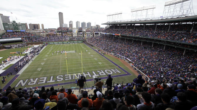 Illinois play against Northwestern during the first quarter of an NCAA college football game at Wrigley Field, home of the Chicago Cubs basebal team, in Chicago on Saturday, Nov. 20, 2010. (AP Photo/Nam Y. Huh)