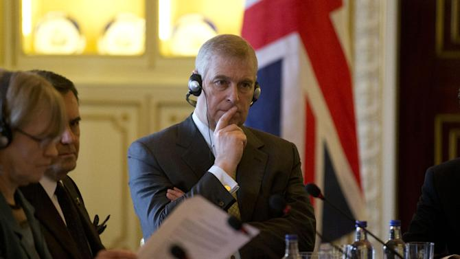 Britain's Prince Andrew listens as he sits at the top of the table with Mexican President Enrique Pena Nieto and British Deputy Prime Minister and leader of the Liberal Democrats party Nick Clegg, during a business breakfast meeting at Buckingham Palace in London, Wednesday, March 4, 2015.  The Mexican President is on the second day of his three-day state visit to Britain.  (AP Photo/Matt Dunham, Pool)