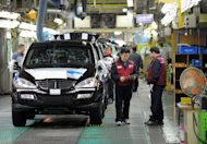 This file photo shows employees working on the production line at the Ssangyong plant in Pyeongtaek, south of Seoul, in 2010. S.Korea's industrial output increased at a faster rate in May than in the preceding month, beating forecasts, according to the latest figures