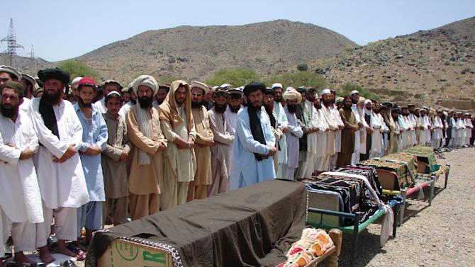 FILE - In this Thursday, June 16, 2011 file photo, Pakistani villagers offer funeral prayers for people who were reportedly killed by a U.S. drone attack in Miranshah, capital of Pakistani tribal region of North Waziristan along the Afghanistan border. The U.S. and Pakistan are starting to look more like enemies than friends, threatening the U.S. fight against Taliban and al-Qaida militants based in the country and efforts to stabilize neighboring Afghanistan before American troops withdraw. (AP Photo/Hasbunullah, File)