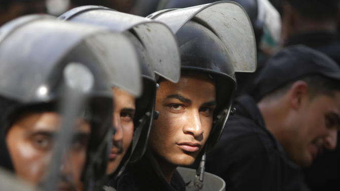 Egyptian anti-riot soldiers prevent opposition activists from getting close to the Shura Council, the upper house of Parliament, during a protest against the new judicial law in Cairo, Egypt, Saturday, May 25, 2013. (AP Photo/ Amr Nabil)