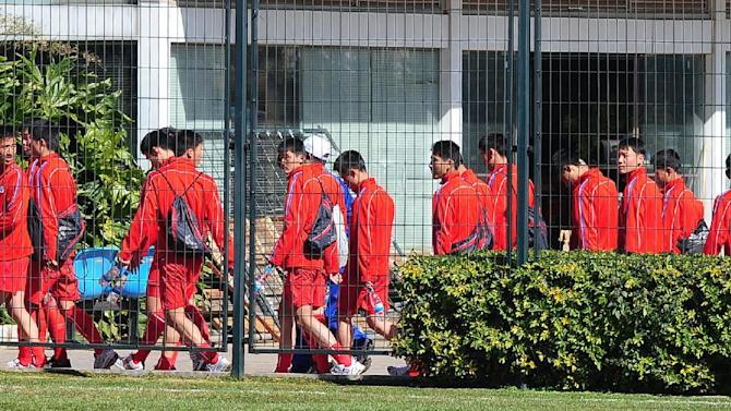 In this Tuesday, Jan. 31, 2012 photo, North Korea's under-14 team 4.25, run by North Korea's military athletes corps, leave from the stadium after they boycotted a scheduled game at Kunming in China's Yunnan Province. The North Korean youth football team has boycotted a game against a South Korean squad amid renewed animosity between the two countries. (AP Photo/Korea Pool) KOREA OUT