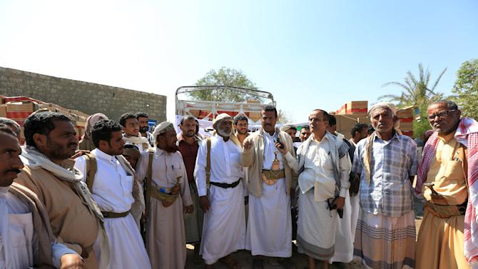 Tribal leaders gather at the site where aid provided by the UAE Red Crescent is being distributed in Yemen's northern province of Marib