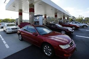 People fill up their tanks with gasoline at a Costco Gas Station in Carlsbad, California