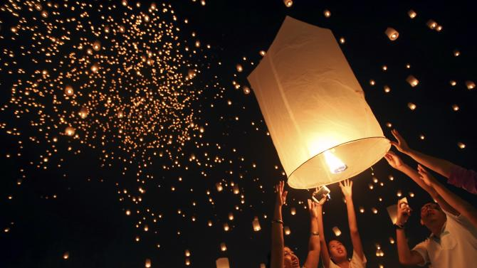 People release thousands of floating lanterns during the festival of Yee Peng in the northern capital of Chiang Mai