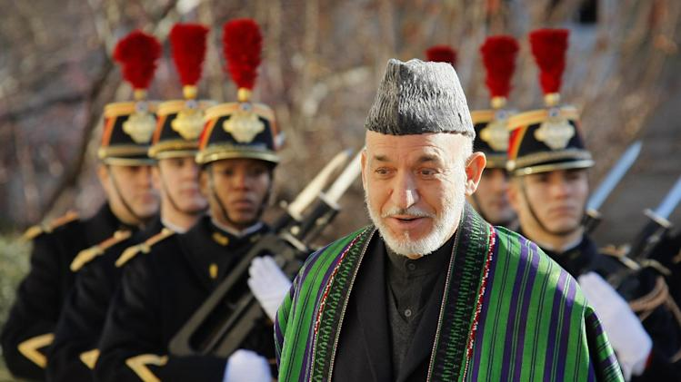 Afghan President Hamid Karzai reviews the honor guard during his arrival at the French National Assembly in Paris, Friday, Jan. 27, 2012. (AP Photo/Michel Spingler)