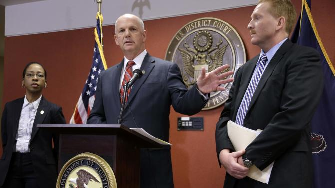 United States Attorney David J. Hicton, center, flanked by Akeia P. Conner, special agent in charge of Internal Revenue Service Ingvestigations, left, and Doug Perdue, special agent in charge or the Pittsburgh Division of the Federal Bureau of Investigation, announces that a federal grand jury in Pittsburgh has indicted retired Pittsburgh Police Chief Nate Harper on charges of conspiracy and willful failure to file income tax returns,  Friday, March 22, 2013 in Pittsburgh. (AP Photo/Gene J. Puskar)