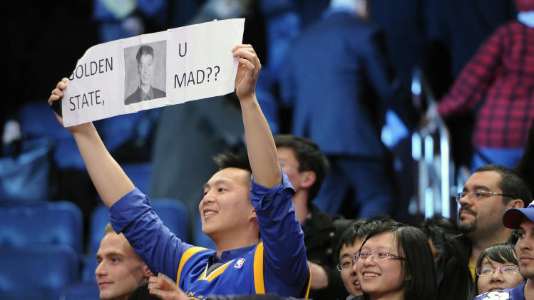 Fans hold up a banner for New York Knicks guard Jeremy Lin during the Knicks' NBA basketball game against the Utah Jazz on Monday, Feb. 6, 2012, in New York. Lin scored 28 points during the Knicks' 99-88 win. (AP Photo/Kathy Kmonicek)