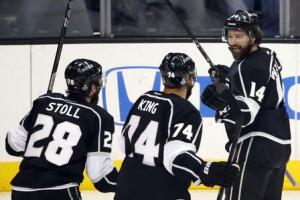 Los Angeles Kings' Williams celebrates his goal against New York Rangers with teammates King and Stoll during Game 5 of their NHL Stanley Cup Finals hockey series in Los Angeles