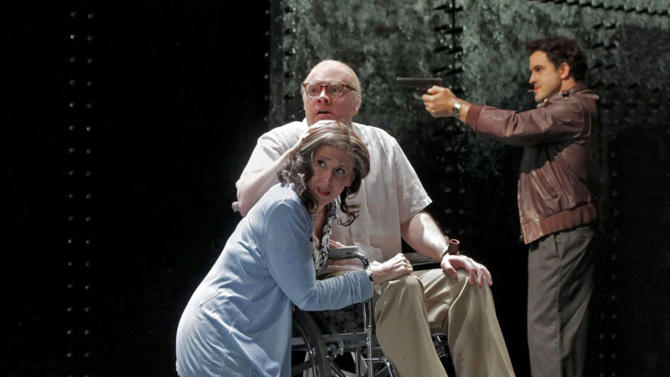 "In this photograph provided by Opera Theatre of Saint Louis, Brian Mulligan as Leon Klinghoffer, Nancy Maultsby as Marilyn Klinghoffer, and Matthew DiBattista as Molqi perform during a rehearsal of the opera ""The Death of Klinghoffer"" Monday, June 13, 2011 in St. Louis. (AP Photo/Opera Theatre of Saint Louis, Ken Howard)"