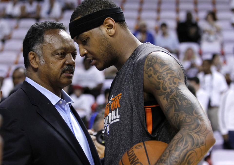 The Rev. Jesse Jackson, left, talks with New York Knicks' Carmelo Anthony, right, before an NBA basketball game against the Miami Heat in the first round of the Eastern Conference playoffs in Miami, Monday, April 30, 2012. (AP Photo/Lynne Sladky)