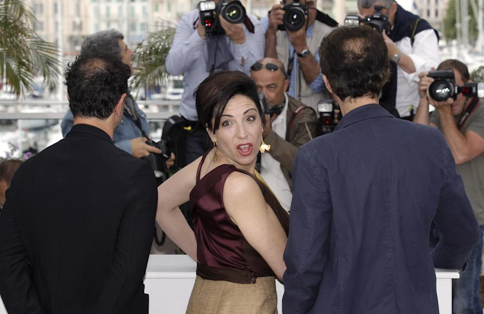 Director Matteo Garrone, left, actors Loredana Simioli and Nando Paone pose during a photo call for Reality at the 65th international film festival, in Cannes, southern France, Friday, May 18, 2012. (AP Photo/Lionel Cironneau)